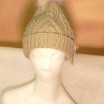 Classic cable knit tuque with coyote pom pom