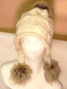 Cream tuque with three coyote fur pompoms